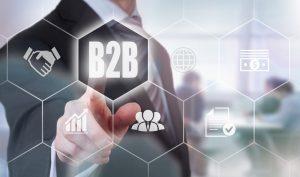 Hand pushing B2B button