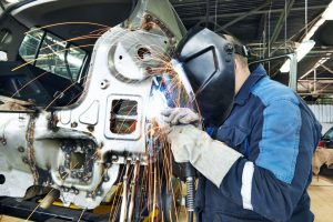 Worker at car manufacturing plant