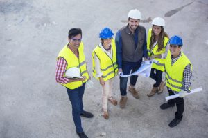 Construction employees smiling because construction public relations is helping them grow.