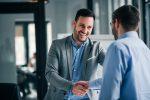 man shaking hands on franchise deal