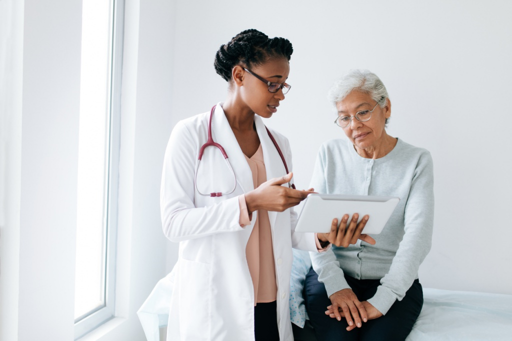 doctor consulting with senior patient