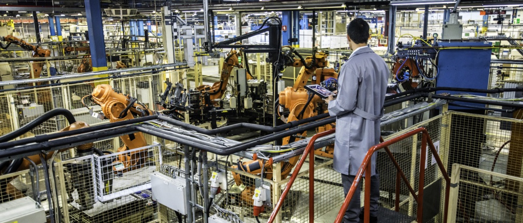 Engineer overseeing automated production process in a factory stock photo