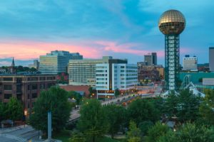 A Knoxville city scape featuring the sunshphere.